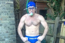 A brave Evertonian is embracing the cold in nothing but Speedos to raise money and awareness for a hospice.
