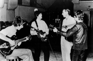 George Martin (third from left) with The Beatles in the Abbey Road studios in 1966. Pic © Capitol Records / Wikimedia Commons