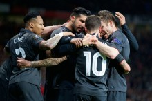 Philippe Coutinho's goal earned Liverpool a 1-1 draw to knock Manchester United out of the Europa League at Old Trafford.