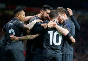 Liverpool celebrate Philippe Coutinho's Europa League away goal against Manchester United at Old Trafford. Pic © David Rawcliffe / Propaganda Photo