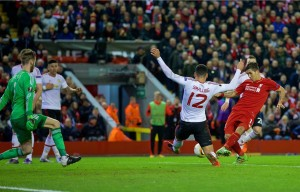 Roberto Firmino scores for Liverpool from the penalty spot against Manchester United. Pic © David Rawcliffe / Propaganda Photo