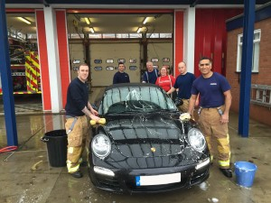 Firefighters in action for charity © FireFighter charity