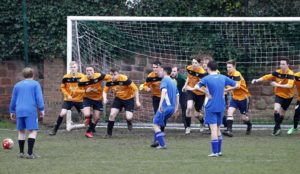The first years charge down an indirect free-kick in the box. Pic © Craig Galloway