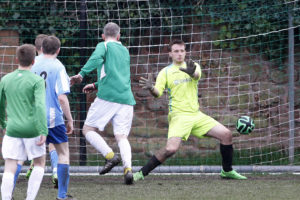 Jeff McGlinchey heads in the opener for the Alumni past Level 2 goalkeeper Tom Begbie. Pic © Craig Galloway