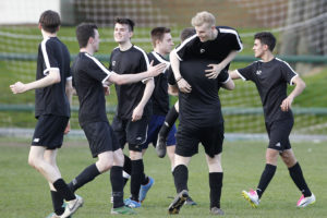 Ed Baldwin is raised aloft by Level 1 team-mates after scoring against the Alumni in the JMU Journalism World Cup Final. Pic © Craig Galloway