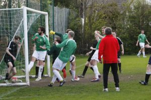 Matt Crosby (far right) put the Alumni in front against Level 1 in the JMU Journalism World Cup Final with a goal direct from a corner. Pic © Craig Galloway