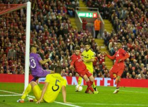 Adam Lallana scores the third goal for Liverpool against Villarreal. Pic © David Rawcliffe / Propaganda Photo