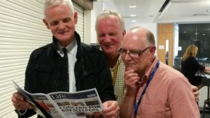 ITN Managing Editor Robin Elias reads our Liverpool Life Newspaper with lecturers Richard Rudin and Steve Harrison at the LSS Graduation Show. Pic © JMU Journalism