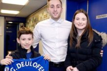 An inspirational young Everton fan who has touched the hearts of Blues fans has raised hundreds of pounds for charity.