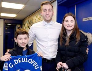 Ceberal palsy victim George Shaw with Everton star Gerard Deulofeu and George's sister Olivia. Pic © David Shaw