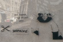 Street art lovers may have been fooled by a fake Banksy painting that appeared in Liverpool.