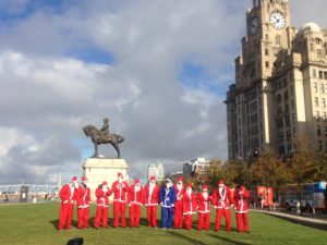 Santas lining up by the Liver Building at the Santa Dash launch. Pic by Rosie Steedman © JMU Journalism