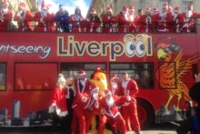 A group of Father Christmas lookalikes toured the city on an open top bus to launch this year's Liverpool Santa Dash.