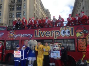 Santas and charity representatives posing by open top city bus. Pic by Rosie Steedman © JMU Journalism