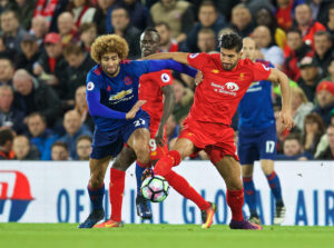 Manchester United's Marouane Fellaini challenges Liverpool's Emre Can at Anfield. Pic © David Rawcliffe Propaganda Photo