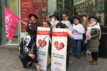 A small group of union members marched through Liverpool in protest over Post Office cuts.