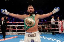 Liverpool's Tony Bellew beat BJ Flores in the third round to defend his WBC World Cruiserweight title at the Echo Arena.