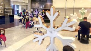 Artists work on snowflakes for the trail Pic © Andrew Evans