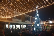 Former X Factor finalists Reggie 'n' Bollie flicked the switch and lit up Kirkby's Christmas lights.