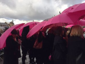 Pink umbrellas were the order of the day at Herbert Howe's funeral. Pic by Laura Hughes © JMU Journalism