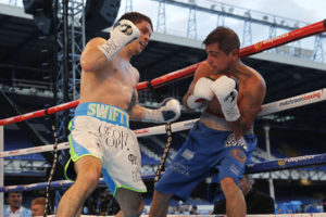 Stephen Smith (left) in action against Daniel Brizuela at Goodison Park in May. Pic © Lawrence Lustig Matchroom Boxing
