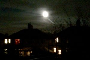Supermoon seen through the clouds in Childwall. Pic © JMU Journalism