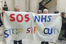 Demonstrators gathered at Liverpool's Cunard Building to protest against NHS cuts and privatisation.