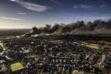 A huge fire in Prescot could be seen as far as 40 miles away, with Merseyside firefighters tackling the blaze.