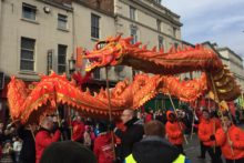 Hundreds braved the cold weather in Liverpool's Chinatown to welcome the Chinese New Year of the Rooster.