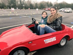 Young driver at the wheel with his mum at a Haydock Park event. Pic by Andrew Nuttall © JMU Journalism