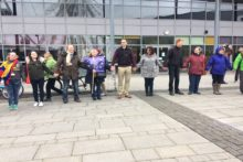 A 'human chain' celebrated the contribution of migrants to the UK at the King's Dock.