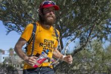 A Croxteth vet is re-creating Forrest Gump's run across the United States to help wildlife and victims of war.
