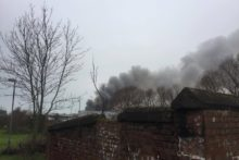 Firefighters have taken control of the blaze at Alexandra Dock in Bootle after three days of tackling the fire.