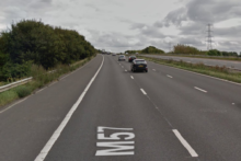 Police are investigating how a seriously injured woman came to be on the M57 after she was found on the hard shoulder near Kirkby.