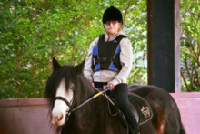 A Liverpool woman is reaching out for help to aid her dreams of becoming a Paralympic horse rider.
