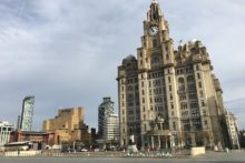 Work has started on the restoration of one of the Royal Liver Building's giant clocks after it stopped ticking earlier this year.