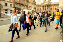 The chance to take a silent dancing tour around Liverpool is proving a popular new attraction.