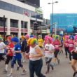 A sea of retro Liverpool 80s-style perms were on show as thousands took part in the Echo Scouse 5k fun run.