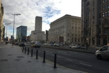 Liverpool's roads chief says narrowing down the number of lanes on The Strand could mean shorter driving times.
