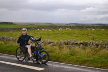 An amuptee cancer patient hand-cycled along Hadrian's Wall to help raise money in his battle for survival.