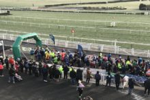Almost 2,000 runners shrugged off the chilly weather in a huge race at the home of the Grand National.