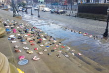 More than 200 pairs of children's shoes were left at St George's Hall to mark young people who commit suicide.