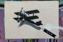 A Banksy painting which went missing has mysteriously reappeared in its former city centre location.