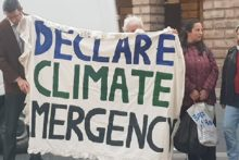 Activists urging the council to join local authorities in declaring a 'climate emergency' held a Town Hall protest.