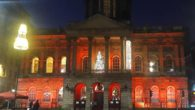 Landmarks across the city lit up red in honour of World Aids Day as a vigil was held.