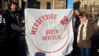 More than 200 protesters marched through Liverpool city centre demanding government action over the climate emergency.