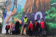 A mural dedicated to supporters of Wirral foodbanks has been unveiled by renowned artist Paul Curtis in Birkenhead.