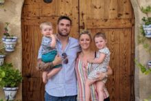 A dad-of-two who suffered a brain haemorrhage has had over £25,000 raised by to help his young family.