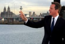 PM David Cameron told locals that the council is adequately funded during a visit to Liverpool, despite claims that cuts may cause riots.