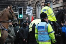 Hundreds of protesters gathered at Liverpool Town Hall as the council passed a budget including a council tax rise and more cuts.